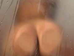 Caprice masturbates using the showerhead coupled with vibrator to hand the same time